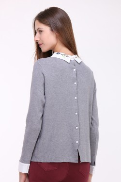 Pull col fleurie dos boutons