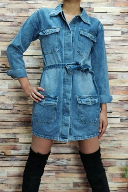 Long denim jacket with 4 front pockets and a belt at the waist.